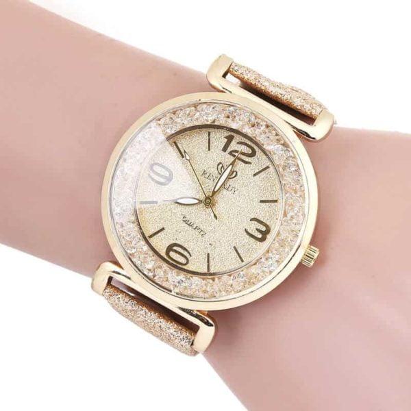 prestižna ženska ura zlate barve