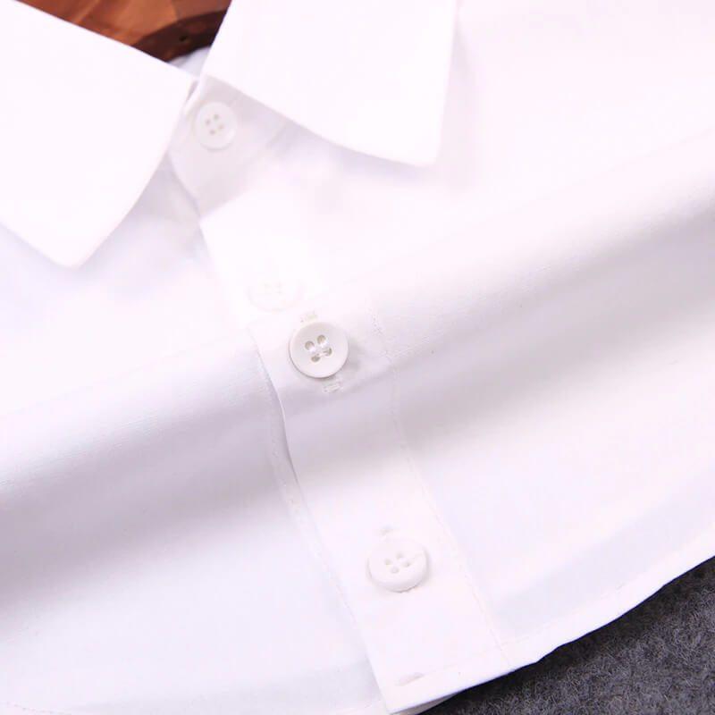 gumbi na ženski srajci