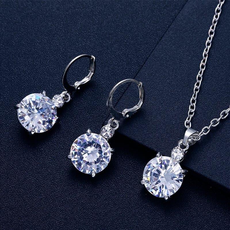 srebrni kristalni uhani z verižico z diamantom
