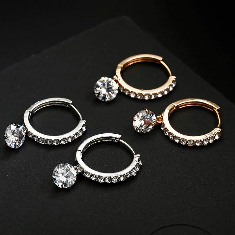 uhani srebrni in zlati s kristali in diamanti