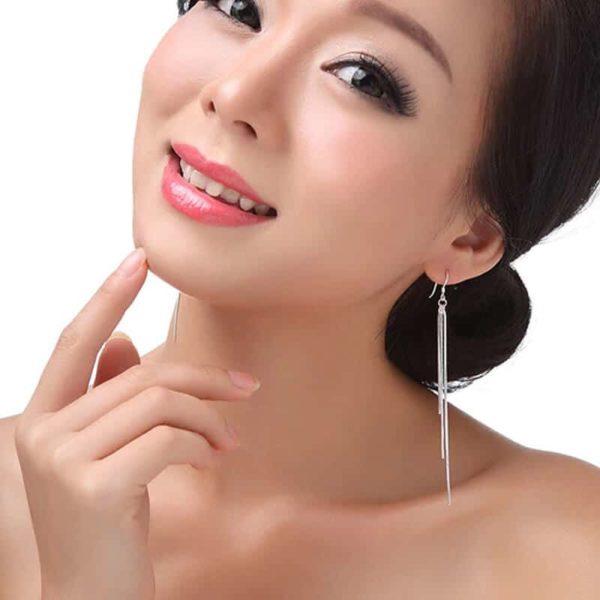 uhani za ženske viseči dolgi