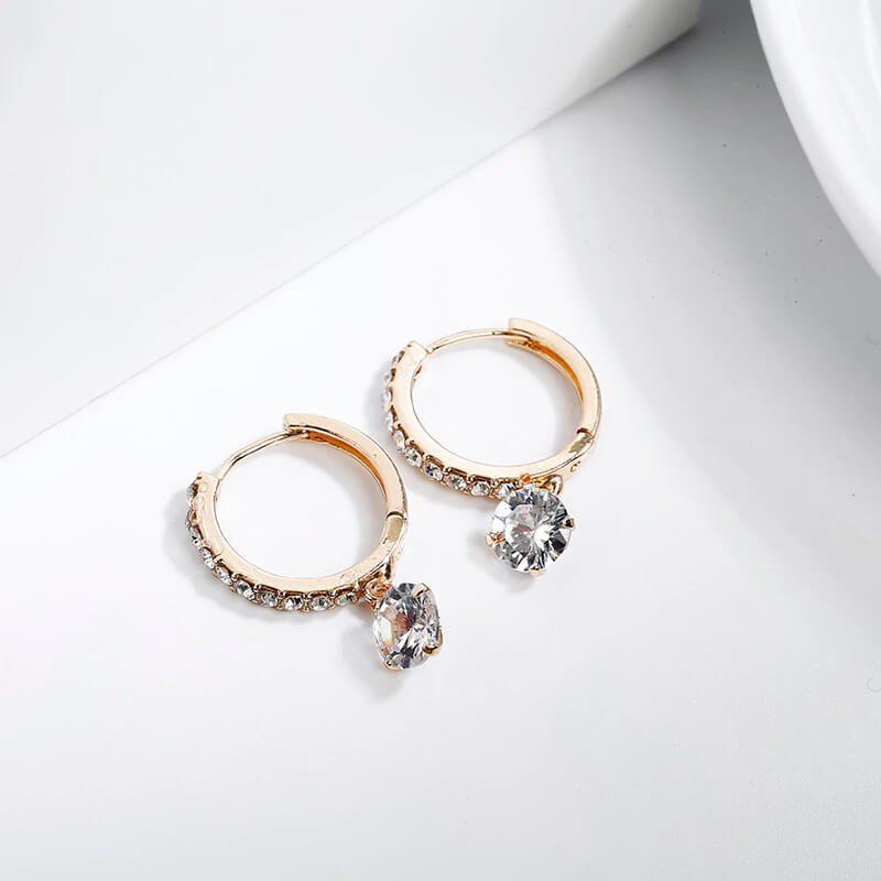 uhani zlati s kristali in diamanti