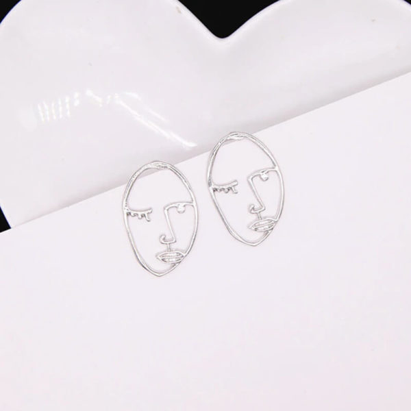 ženski srebrni abstraktni uhani modni