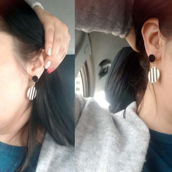 dolgi viseči zhani na ženskem ušesu