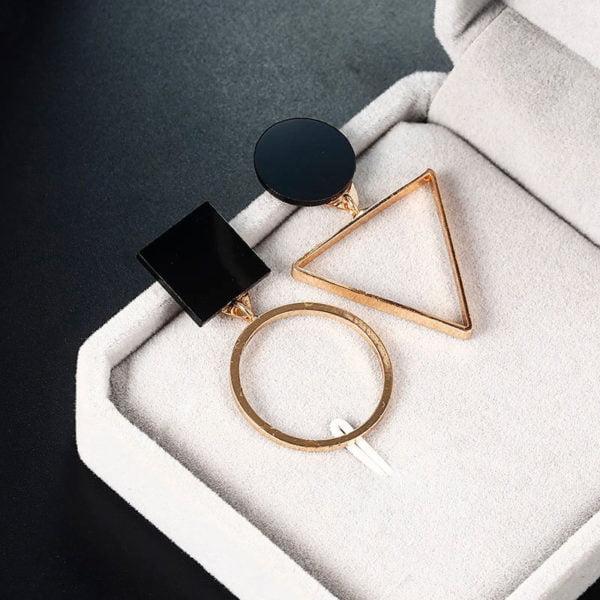 modni zlati viseči uhani