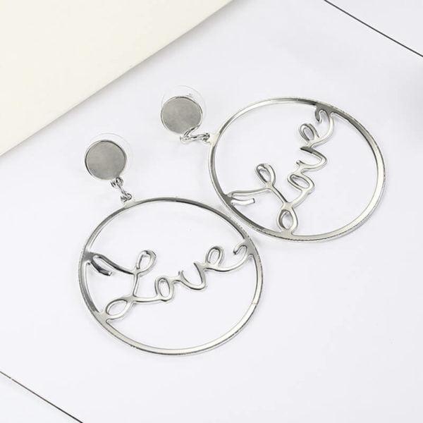 srebrni uhani love za ženske