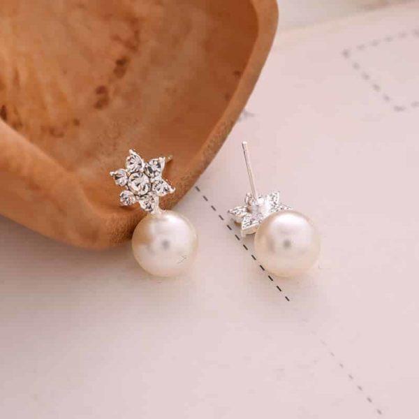 srebrni uhani z biseri in zvezdo