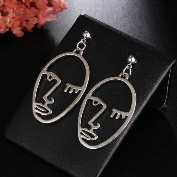 uhani srebrni z vzorcem obraza modni