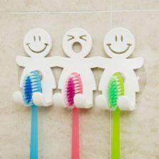 Držalo za zobne ščetke s smeškoti