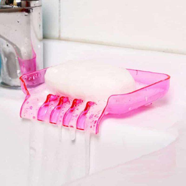 držalo za milo roza barve s tehnologijo odtekanja