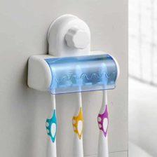 najboljše držalo za zobne ščetke pritrjeno na steno