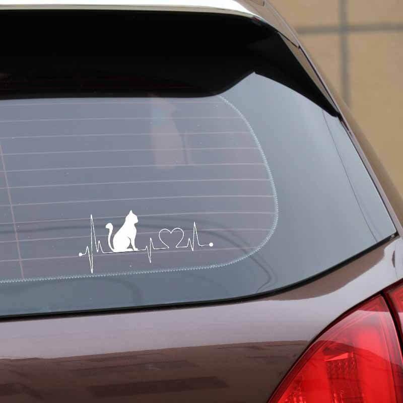 nalepka na avtomobilu mačka bele barve