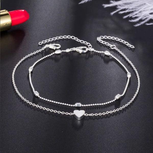 srebrna zapestnica za nogo s srcem in dodatno zapestnico