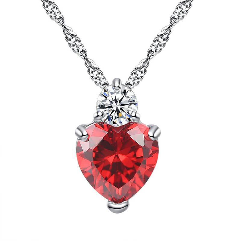 verižica srebrne barve z diamantom in kristalom srce