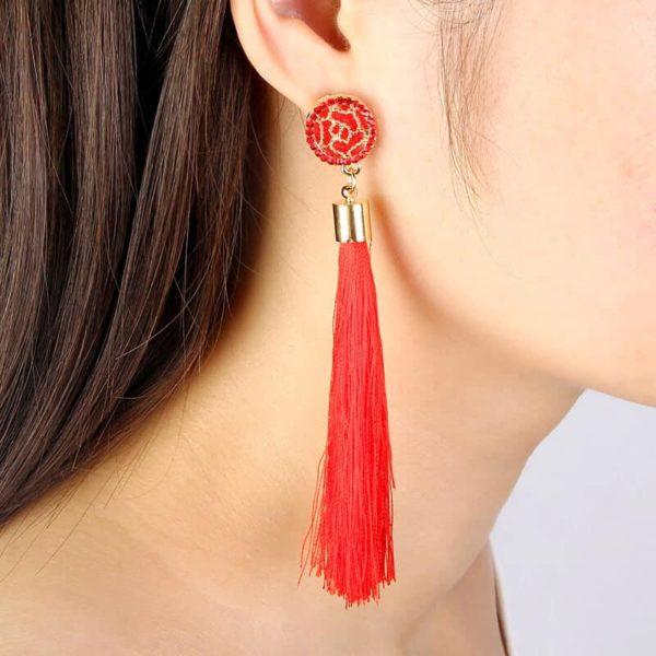 Dolgi viseči uhani z simbolom krone