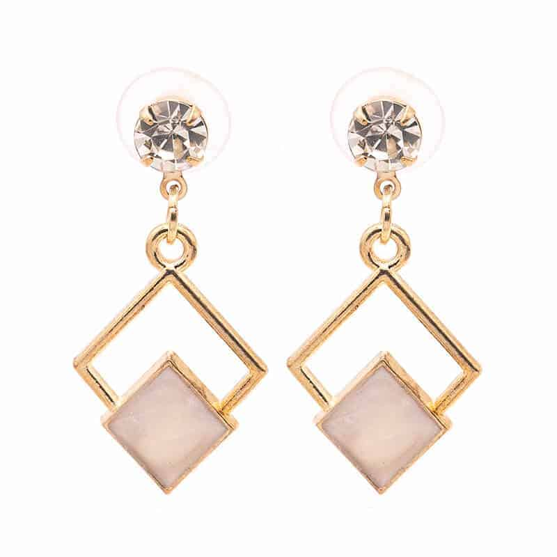 zlati viseči uhani z kamnom in kristalom