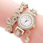 zlata ročna ženska ura z diamanti in napisom love