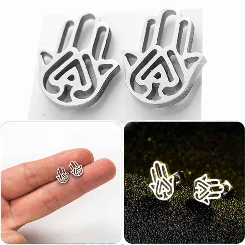 minimalistični uhani srebrne barve roka življenja